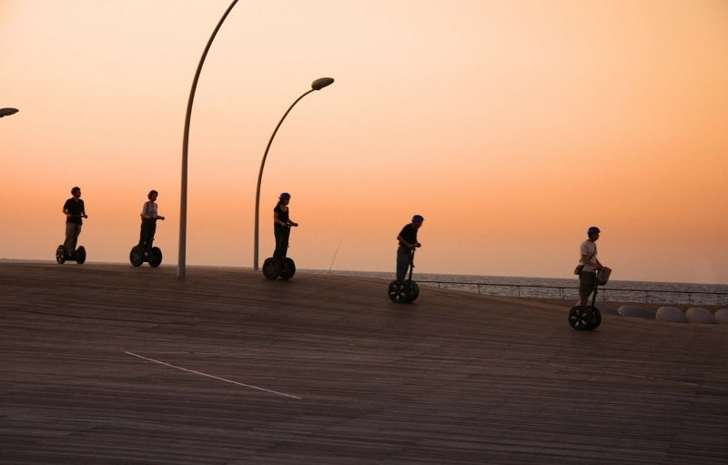 Segways At Sunset Along The Boardwalk